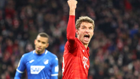 <p>               Bayern's Thomas Mueller, right, celebrates after scoring his side's second goal, during the German soccer cup, DFB Pokal, match between FC Bayern Munich and TSG Hoffenheim in Munich, Germany, Wednesday, Feb. 5, 2020. (AP Photo/Matthias Schrader)             </p>