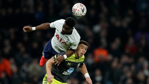 <p>               Tottenham's Tanguy Ndombele heads the ball above Southampton's Jan Bednarek, right, during the English FA Cup fourth round replay soccer match between Tottenham Hotspur and Southampton at the Tottenham Hotspur Stadium in London, Wednesday, Feb. 5, 2020. (AP Photo/Kirsty Wigglesworth)             </p>