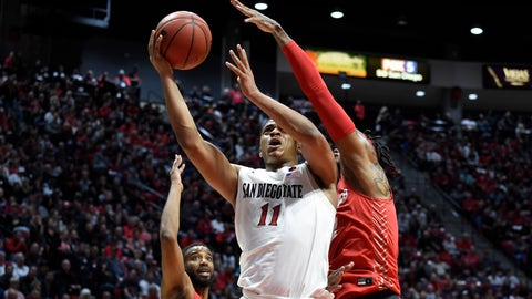 <p>               San Diego State forward Matt Mitchell (11) shoots past the defense of New Mexico guard Vance Jackson (2) during the first half of an NCAA college basketball game Tuesday, Feb. 11, 2020, in San Diego. (AP Photo/Denis Poroy)             </p>