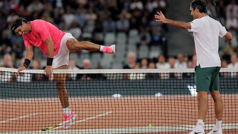 <p>               Rafael Nadal, left, jumps the net while Roger Federer watches on during their exhibition tennis match held at the Cape Town Stadium in Cape Town, South Africa, Friday Feb. 7, 2020. (AP Photo/Halden Krog)             </p>