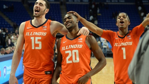 <p>               Illinois' Giorgi Bezhanishvili (15), Da'Monte Williams (20) and Trent Frazier (1) leave the court after Illinois defeated Penn State 62-56 in an NCAA college basketball game Tuesday, Feb. 18, 2020, in State College, Pa. (AP Photo/Gary M. Baranec)             </p>