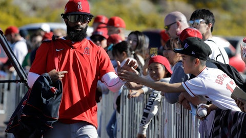 <p>               Los Angeles Angels' Brian Goodwin, left, greets a fan during spring training baseball practice, Monday, Feb. 17, 2020, in Tempe, Ariz. (AP Photo/Darron Cummings)             </p>