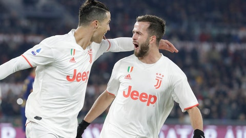 <p>               Juventus' Cristiano Ronaldo, left, celebrates with teammate Miralem Pjanic after scoring his side's second goal during the Serie A soccer match between Roma and Juventus at the Rome Olympic Stadium, Italy, Sunday, Jan. 12, 2020. (AP Photo/Andrew Medichini)             </p>