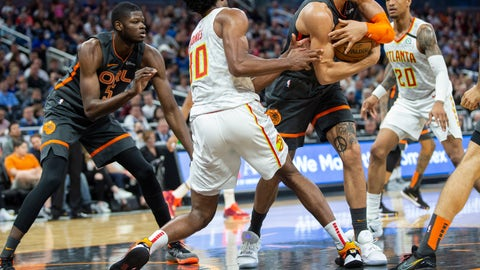 <p>               Orlando Magic forward Aaron Gordon (00) fights for the ball with Atlanta Hawks center Damian Jones (30) and forward John Collins (20) during the first half of an NBA basketball game in Orlando, Fla., Monday, Feb. 10, 2020. (AP Photo/Willie J. Allen Jr.)             </p>