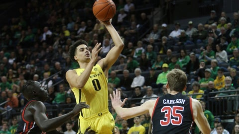 <p>               Oregon's Will Richardson, center, shoots between Utah's Both Gach, left, and Branden Carlson during the first half of an NCAA college basketball game in Eugene, Ore., Sunday, Feb. 16, 2020. (AP Photo/Chris Pietsch)             </p>