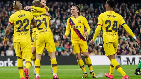 <p>               From left to right: Barcelona players Arturo Vidal, Frenkie de Jong, Lionel Messi, Antoine Griezmann and Junior Firpo celebrate their team first goal during La Liga soccer match between Betis and Barcelona at the Benito Villamarin stadium in Seville, Spain, Sunday, Feb. 9, 2020. (AP Photo/Miguel Morenatti)             </p>