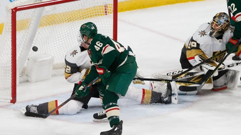 <p>               Minnesota Wild's Jared Spurgeon, left, scores a power play goal against Vegas Golden Knights' goalie Marc-Andre Fleury, right, in the first period of an NHL hockey game Tuesday, Feb. 11, 2020, in St. Paul, Minn. (AP Photo/Jim Mone)             </p>