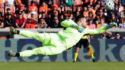 <p>               Houston Dynamo goalkeeper Marko Maric (1) blocks a shot on goal during the second half of an MLS soccer match against the Los Angeles Galaxy, Saturday, Feb. 29, 2020, in Houston. (AP Photo/Michael Wyke)             </p>