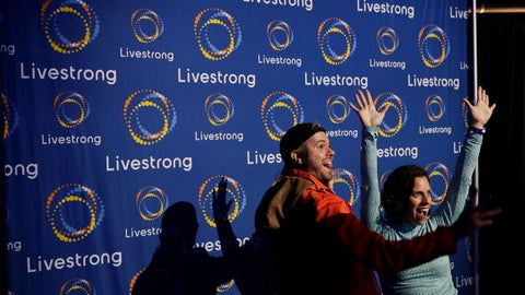 <p>               In this Monday, Feb. 3, 2020 photo, guest pose with a new logo for Livestrong at an event in Austin, Texas. The Livestrong cancer charity is on a mission to reinvent itself. It has survived a dramatic fall in contributions and donations since founder Lance Armstrong's performance-enhancing drug scandal. (AP Photo/Eric Gay)             </p>