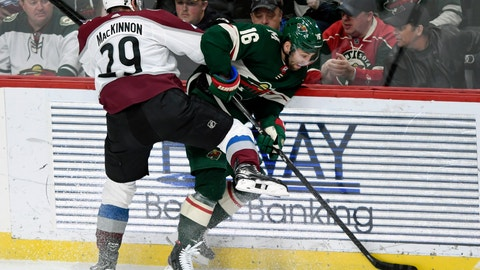 <p>               Colorado Avalanche's Nathan MacKinnon (29) pins Minnesota Wild's Jason Zucker (16) to the boards during the third period of an NHL hockey game Sunday, Feb. 9, 2020, in St. Paul, Minn. The Avalanche won 3-2. (AP Photo/Hannah Foslien)             </p>