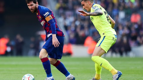 <p>               Barcelona's Lionel Messi, left, controls the ball under pressure from Getafe's Mauro Arambarri during a Spanish La Liga soccer match between Barcelona and Getafe at the Camp Nou stadium in Barcelona, Spain, Saturday Feb. 15, 2020. (AP Photo/G.Garin)             </p>