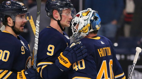 <p>               Buffalo Sabres forward JAck Eichel (9) and goalie Carter Hutton (40) celebrate a 2-1- victory following the overtime period of an NHL hockey game against the Columbus Blue Jackets, Saturday, Feb. 1, 2020, in Buffalo, N.Y. (AP Photo/Jeffrey T. Barnes)             </p>