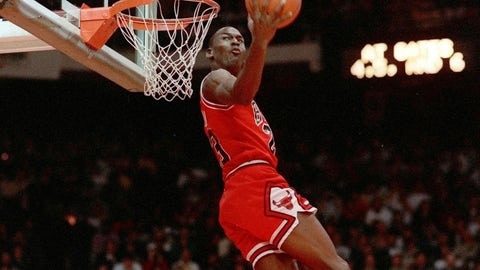 <p>               FILE - In this Feb. 6, 1988, file photo, Chicago Bulls' Michael Jordan dunks during the slam-dunk competition of the NBA All-Star weekend in Chicago.  Jordan left the old Chicago Stadium that night with the trophy. To this day, many believe Wilkins was the rightful winner.  (AP Photo/John Swart)             </p>