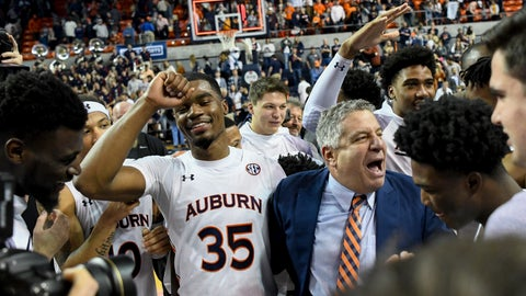 <p>               Auburn head coach Bruce Pearl celebrates with players after a win over Tennessee in an NCAA college basketball game Saturday, Feb. 22, 2020, in Auburn, Ala. (AP Photo/Julie Bennett)             </p>