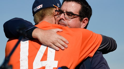 <p>               Associate coach Nate Johnson, left, hugs Tony Altobelli during a ceremony held for John Altobelli, the late head coach of Orange Coast College baseball, who died in a helicopter crash alongside former NBA basketball player Kobe Bryant in Costa Mesa, Calif., Tuesday, Jan. 28, 2020. His wife Keri and youngest daughter Alyssa were also victims of the crash. (AP Photo/Kelvin Kuo)             </p>