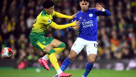 <p>               Norwich City's Jamal Lewis, left, and Leicester City's Ayoze Perez battle for the ball during the English Premier League soccer match at Carrow Road, Norwich, Friday Feb. 28, 2020. (Joe Giddens/PA via AP)             </p>