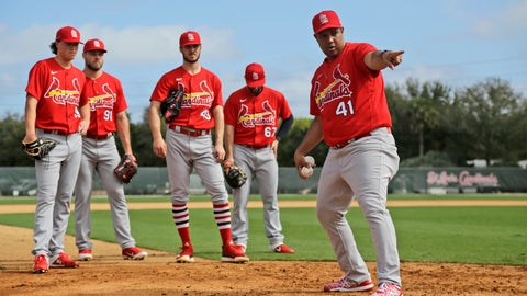 <p>               St. Louis Cardinals pitchers listen as coach Dernier Orozco (41) instructs them on covering home plate during spring training baseball practice Sunday, Feb. 16, 2020, in Jupiter, Fla. (AP Photo/Jeff Roberson)             </p>