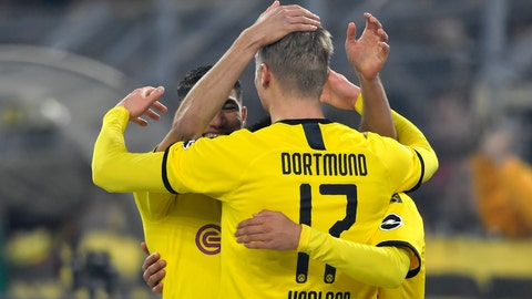 <p>               Dortmund's Erling Braut Haaland, centre, celebrates with teammates after scoring his side's third goal during the German Bundesliga soccer match between Borussia Dortmund and Eintracht Frankfurt in Dortmund, Germany, Friday, Feb. 14, 2020. (AP Photo/Martin Meissner)             </p>