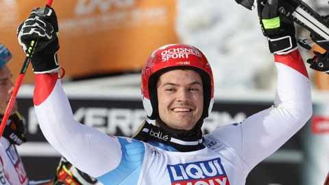 <p>               Switzerland's Loic Meillard celebrates his victory in the finish area during an alpine ski, men's World Cup parallel giant slalom, in Chamonix, France, Sunday, Feb. 9, 2020. (AP Photo/Alessandro Trovati)             </p>