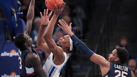 <p>               Memphis forward Precious Achiuwa (55) shoots under pressure from Connecticut's Akok Akok, left, and Josh Carlton (25) during an NCAA college basketball game, Saturday, Feb. 1 2020, at the FedExForum in Memphis, Tenn. (Jim Weber/Daily Memphian via AP)             </p>