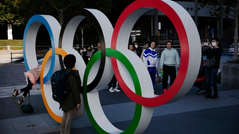 <p>               People wait in line to take pictures with the Olympic rings near the New National Stadium, Sunday, Feb. 23, 2020, in Tokyo. (AP Photo/Jae C. Hong)             </p>