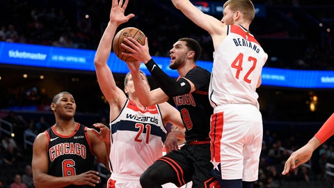 <p>               Chicago Bulls guard Zach LaVine (8) goes to the basket next to Washington Wizards forward Moritz Wagner (21) and forward Davis Bertans (42) during the first half of an NBA basketball game, Tuesday, Feb. 11, 2020, in Washington. (AP Photo/Nick Wass)             </p>