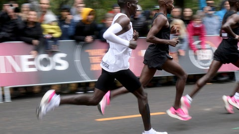 <p>               In this Oct. 12, 2019 photo, marathon runner Eliud Kipchoge from Kenya, white vest, wearing Nike AlphaFly prototype running shoe, and his pacemaking team, wearing pink Nike Vaporfly shoes, run during the INEOS 1:59 Challenge attempt to run a sub two-hour marathon in Vienna, Austria. Nike has a new racing shoe; The Air Zoom Alphafly Next%, which was unveiled at a flashy fashion show in New York on Wednesday night, Feb. 5, 2020. Kipchoge wore a prototype of the shoe when he ran the world's first sub-2-hour marathon in an unofficial race in October.  (AP Photo/Ronald Zak, File)             </p>