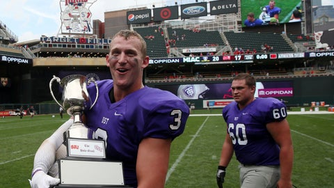 <p>               FILE - In this Sept. 23, 2017, file photo, St. Thomas wide receiver Tanner Vik walks on the field with the Holy Grail trophy after the team's win over St. John's in an NCAA college football game, in Minneapolis. St. John's and St. Thomas will stage their final game as Minnesota Intercollegiate Athletic Conference foes at U.S. Bank Stadium this fall. The 90th edition in the series will be played Nov. 7, 2020. (Anthony Souffle/Star Tribune via AP, File)             </p>