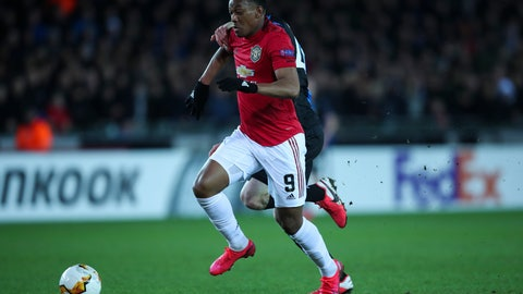 <p>               Manchester United's Anthony Martial, front, vies for the ball with Brugge's Brandon Mechele to score his side first goal during an Europa League round of 32 first leg soccer match between Brugge and Manchester United at the Jan Breydel stadium in Bruges, Belgium, Thursday, Feb. 20, 2020. Martial scored once and the match ended in a 1-1 draw. (AP Photo/Francisco Seco)             </p>