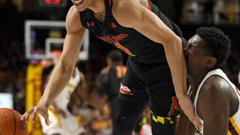 <p>               Minnesota's Isaiah Ihnen trips Maryland's Anthony Cowan Jr. (1) as they go for a loose ball during the first half of an NCAA college basketball game Wednesday, Feb. 26, 2020, in Minneapolis. (AP Photo/Hannah Foslien)             </p>