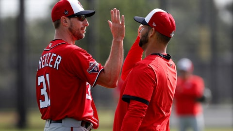 <p>               Washington Nationals pitcher Max Scherzer, left, gets a high-five from fellow pitcher Anibal Sanchez during spring training baseball practice Friday, Feb. 14, 2020, in West Palm Beach, Fla. (AP Photo/Jeff Roberson)             </p>