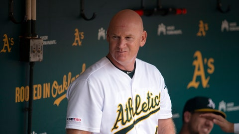 """<p>               FILE - In this Sept. 22, 2019, file photo, Oakland Athletics third base coach Matt Williams is shown in the dugout before a baseball game against the Texas Rangers in Oakland, Calif.  Back managing a team, just being able to talk with his players is a challenge for Matt Williams. About 10 miles from the spring training camps of the Boston Red Sox and Minnesota Twins, the 54-year-old is at spring training with South Korea's Kia Tigers. """"You never know whether you're going to get another chance to manager or not, so I look at it as a challenge or an opportunity,'' he said, sitting in some small metal bleachers. """"So far it's been a lot of fun."""" (AP Photo/D. Ross Cameron, File)             </p>"""