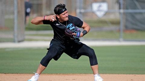 <p>               Miami Marlins shortstop Miguel Rojas runs a drill at spring training baseball camp in Jupiter, Fla., Wednesday, Feb. 12, 2020. (David Santiago/Miami Herald via AP)             </p>