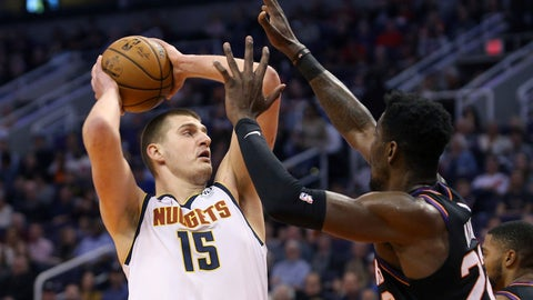<p>               Denver Nuggets center Nikola Jokic (15) looks to shoot as Phoenix Suns center Deandre Ayton (22) defends during the first half of an NBA basketball game, Saturday, Feb. 8, 2020, in Phoenix. (AP Photo/Ralph Freso)             </p>
