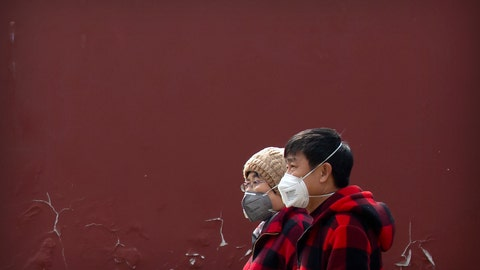 <p>               People wearing face masks walk through a public park in Beijing, Friday, Feb. 21, 2020. China reported a further fall in new virus cases to 889 on Friday as health officials expressed optimism over containment of the outbreak that has caused more than 2,200 deaths and is spreading elsewhere. (AP Photo/Mark Schiefelbein)             </p>