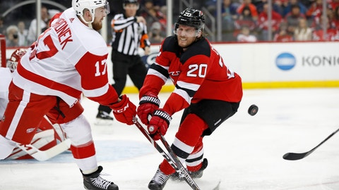 <p>               New Jersey Devils center Blake Coleman (20) blocks as Detroit Red Wings defenseman Filip Hronek (17) tries to flip the puck to a teammate during the second period of an NHL hockey game, Thursday, Feb. 13, 2020, in Newark, N.J. (AP Photo/Kathy Willens)             </p>
