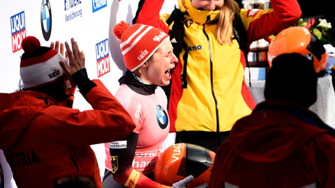 <p>               Winner Tina Hermann of Germany celebrates during the women's Skeleton competition at the Bobsleigh and Skeleton World Championships in Altenberg, eastern Germany, Saturday, Feb. 29, 2020. (AP Photo/Jens Meyer)             </p>
