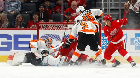 <p>               Philadelphia Flyers goaltender Brian Elliott (37) stops a Detroit Red Wings left wing Darren Helm (43) shot in the first period of an NHL hockey game Monday, Feb. 3, 2020, in Detroit. (AP Photo/Paul Sancya)             </p>
