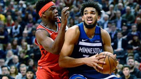<p>               Toronto Raptors guard Terence Davis (0) guards Minnesota Timberwolves centre Karl-Anthony Towns (32) during second half NBA basketball action in Toronto, Monday, Feb. 10, 2020. (Frank Gunn/The Canadian Press via AP)             </p>