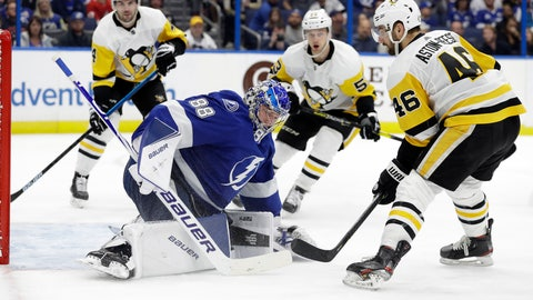 <p>               Tampa Bay Lightning goaltender Andrei Vasilevskiy (88) covers up after a shot by Pittsburgh Penguins center Zach Aston-Reese (46) during the third period of an NHL hockey game Thursday, Feb. 6, 2020, in Tampa, Fla. (AP Photo/Chris O'Meara)             </p>
