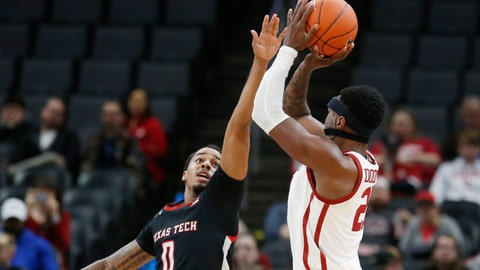 <p>               Oklahoma forward Kristian Doolittle, right, shoots over Texas Tech guard Kyler Edwards (0) in the second half of an NCAA college basketball game Tuesday, Feb. 25, 2020, in Oklahoma City. (AP Photo/Sue Ogrocki)             </p>