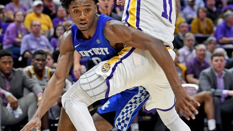 <p>               Kentucky guard Ashton Hagans (0) attempts to go around LSU guard Charles Manning Jr. (11) while driving to the basket during the first half of an NCAA college basketball game Tuesday, Feb. 18, 2020, in Baton Rouge, La. (AP Photo/Bill Feig)             </p>
