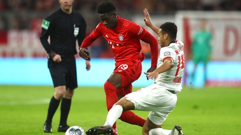 <p>               Bayern's Alphonso Davies, centre, and Leipzig's Tyler Adams challenge for the ball during the German Bundesliga soccer match between Bayern Munich and RB Leipzig at the Allianz Arena in Munich, Germany, Sunday, Feb. 9, 2020. (AP Photo/Matthias Schrader)             </p>
