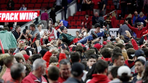 <p>               North Carolina State fans storm the court following the team's win over Duke in an NCAA college basketball game in Raleigh, N.C., Wednesday, Feb. 19, 2020. (AP Photo/Gerry Broome)             </p>