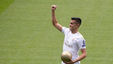 <p>               Brazilian player Rainier gestures to fans during his official presentation after signing for Real Madrid at the Santiago Bernabeu stadium in Madrid, Spain, Tuesday, Feb. 18, 2020. (AP Photo/Paul White)             </p>