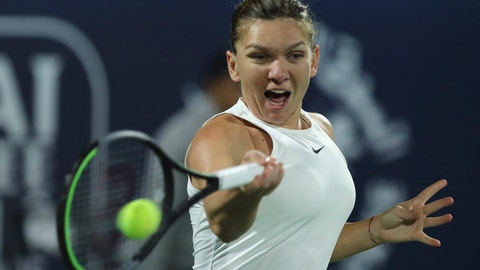 <p>               Romania's Simona Halep returns the ball to Tunisia's Ons Jabeur during a match of the Dubai Duty Free Tennis Championship in Dubai, United Arab Emirates, Wednesday, Feb. 19, 2020. (AP Photo/Kamran Jebreili)             </p>