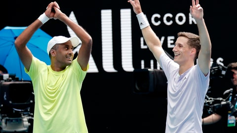 <p>               Rajeev Ram, left, of the U.S. and partner Britain's Joe Salisbury celebrate after defeating Australia's Max Purcell and Luke Saville in the men's doubles final at the Australian Open tennis championship in Melbourne, Australia, Sunday, Feb. 2, 2020. (AP Photo/Lee Jin-man)             </p>