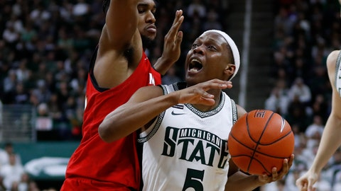 <p>               Michigan State guard Cassius Winston (5) drives on Maryland forward Donta Scott (24) in the second half of an NCAA college basketball game in East Lansing, Mich., Saturday, Feb. 15, 2020. (AP Photo/Paul Sancya)             </p>