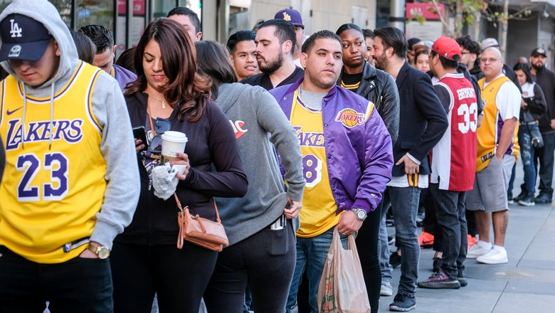 The Latest: Fans take photos before Kobe Bryant memorial