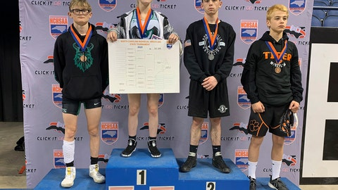 <p>               This photo provided by North Carolina High School Athletic Association (NCHSAA) shows Heaven Fitch, center, Luke Wilson, left, and Hunter Fulp, right, and Brandon Ropp, far right,  after the state wrestling championships in Raleigh, N.C, on Saturday, Feb. 22, 2020.  NCHSAA said on its website that Fitch of Uwharrie Charter became the first female to win one of the association's individual state wrestling championships. She won the 106 pound (48 kg) weight class at the 1A division on Saturday.  (North Carolina High School Athletic Association via AP)             </p>